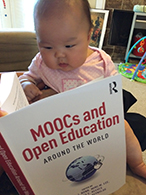 Description: Eunbae Lee's daughter with moocs book